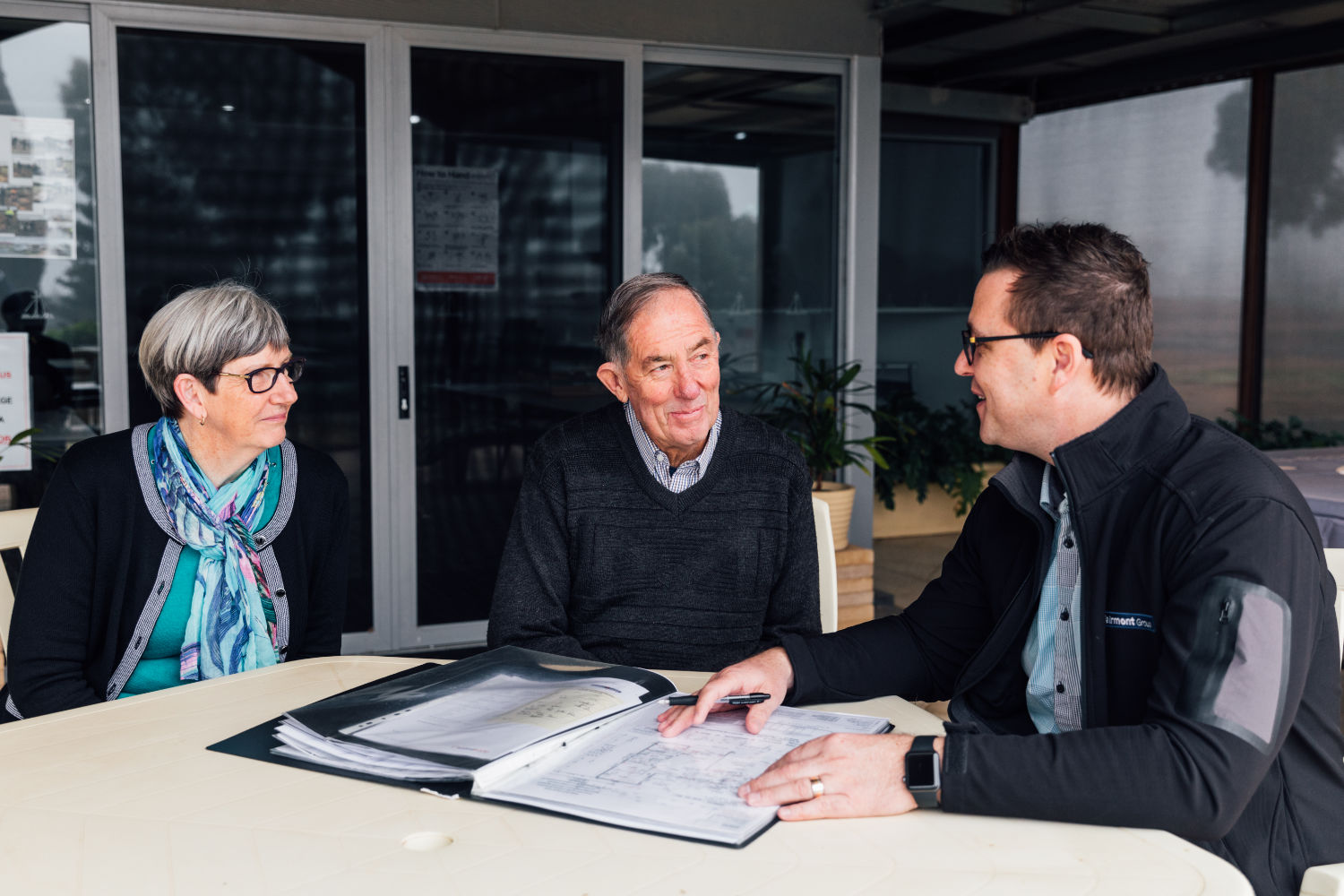 Couple talking to management about building their home