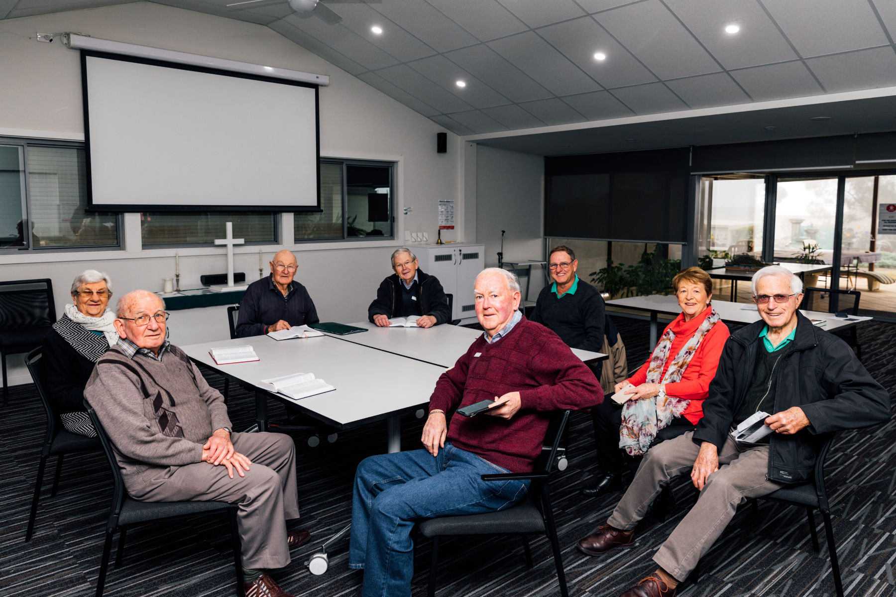 Residents having a meeting around table